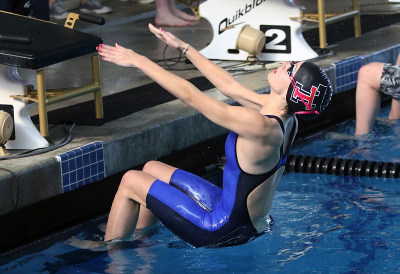 PMG PHOTO: DAN BROOD - Tualatin High School junior Izzy Ehmig gets the Timberwolves 200-yard medley relay team off to a flying start at the Class 6A state swimming championships.