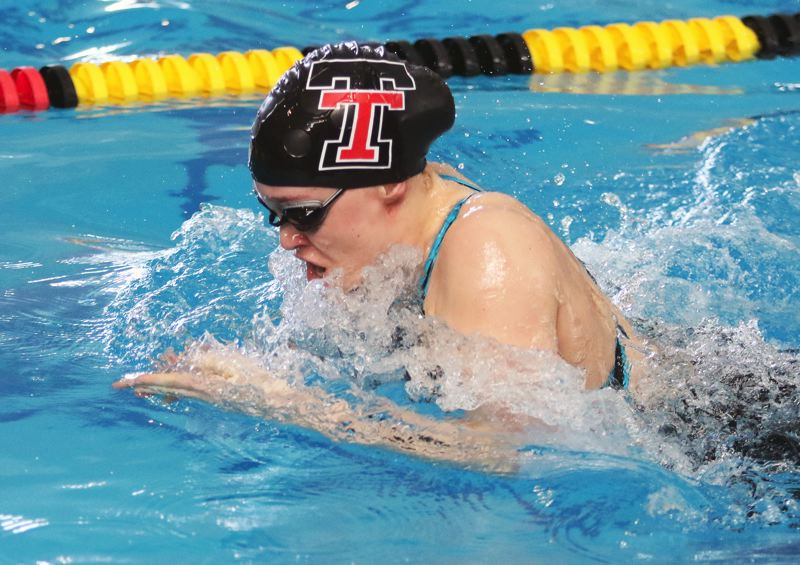 PMG PHOTO: DAN BROOD - Tualatin High School senior Britney Muralt competes in the breaststroke portion of the 200-yard medley relay at the Class 6A state swimming championships.