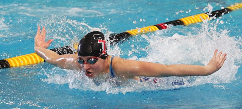 PMG PHOTO: DAN BROOD - Tualatin High School senior Erika Farring competes in the butterfly portion of the 200-yard medley relay event at the Class 6A state swimming championships.
