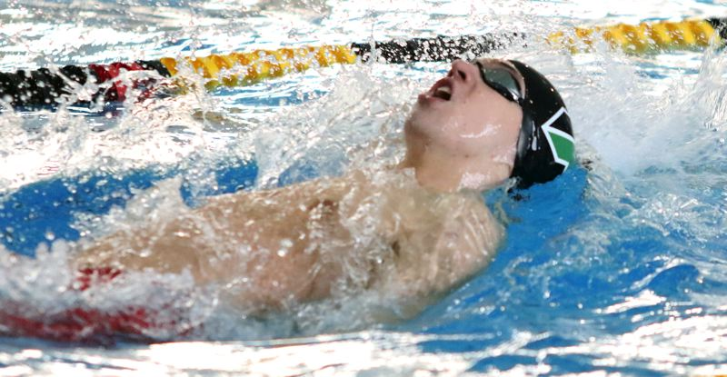PMG PHOTO: DAN BROOD - Tigard junior Nathaniel Whitehead heads to the finish in the 100-yard backstroke finals Saturday at the Class 6A state swimming championships.