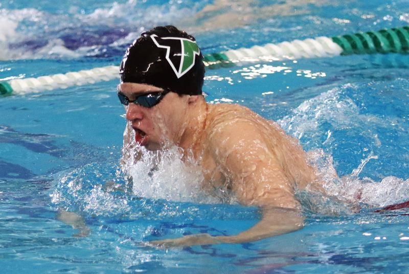 PMG PHOTO: DAN BROOD - Tigard's Nathaniel Whitehead competes in the breaststroke portion of the 200-yard individual medley event Saturday at the Class 6A state swimming championships.