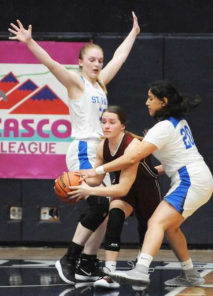 GRAPHIC PHOTO: GARY ALLEN - St. Paul's Mary Davidson (left) and Abby Gonzalez apply stifling defense on a Perrydale player during the Bucks' 44-18 win over the Pirates in the Casco League championship game at George Fox University on Saturday.
