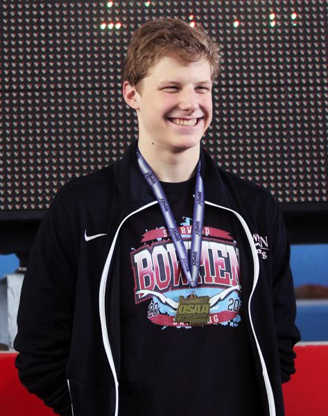 PMG PHOTO: DAN BROOD - Sherwood High School senior Jacob Folsom smiles after receiving his state championship medal following his victory in the 200-yard freestyle event at the Class 6A state swimming championships.