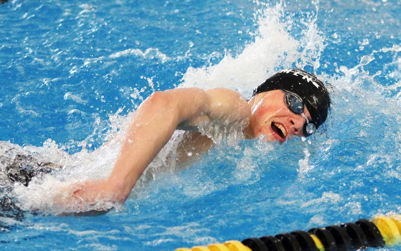 PMG PHOTO: DAN BROOD - Sherwood High School sophomore Seth Hochstetler competes in the second leg of the 400-yard freestyle relay event for the Bowmen at the Class 6A state swimming championships on Saturday.