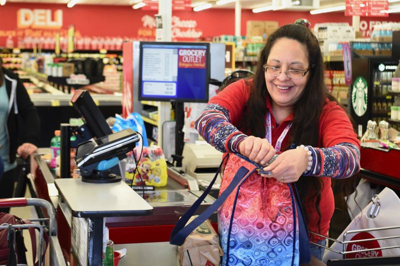 PMG PHOTO: BRITTANY ALLEN - Reusable bags are becoming more of a staple at the Sandy Grocery Outlet.