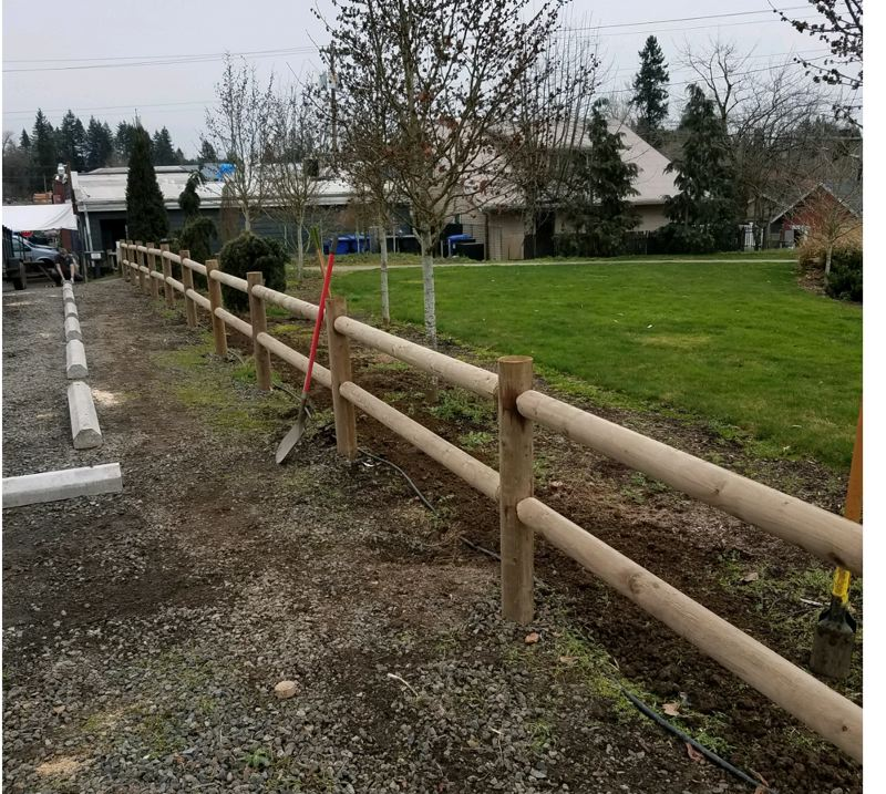 COURTESY PHOTO - Parking stops were moved to avoid future damages by drivers to fencing.