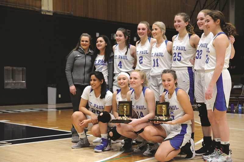 PMG PHOTO: GARY ALLEN - The St. Paul girls basketball team swept the Casco League regular season and tournament titles for the second consecutive year since dropping back to the 1A Classification.