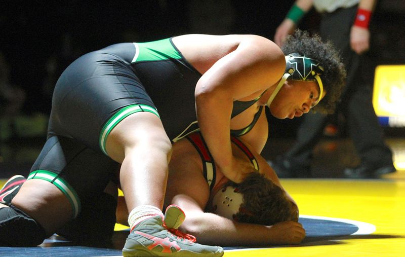 PMG PHOTO: MILES VANCE - Tigard High School senior Johnny Nomani (top), shown here in the Three Rivers League 285-pound district tournament title match, is a No. 2 seed for this week's Class 6A state tournament.