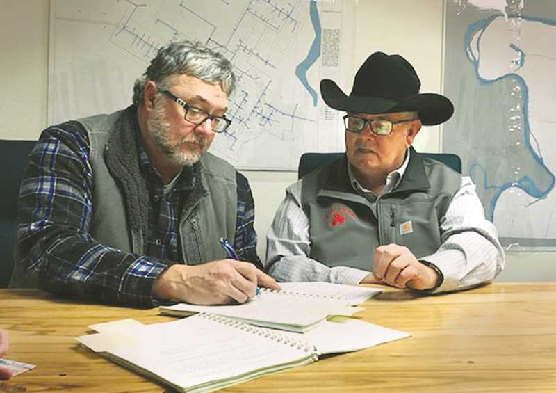 SUBMITTED PHOTO - St. Paul Rodeo Association President Kevin Smith (right) and St. Paul Mayor Martin Waldo signed the agreement on Feb. 13.
