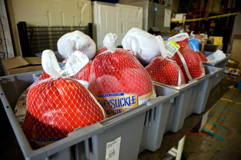 PMG FILE PHOTO: CHRISTINA LENT - Frozen turkeys sit in a bin for people to pick-up at Sunshine Pantry in Beaverton. The pantry is one of three charities participating in 100 People-X.