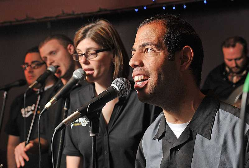PMG FILE PHOTO: GARY STEIN - United by Music North America artists Aaron Hobson (from right), Bethany Ide, Jordan Ackerson and James Ford rehearse a tune. The band of developmentally challenged musicians hopes to show audiences their true talent. United will be participating in 100 People-X.