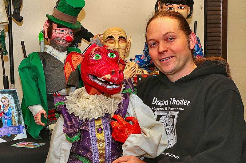 DAVID F. ASHTON - Jason Ropp, of Portlands Dragon Theater Puppets & Princesses, brings some of his rod puppets to the exhibition at the Portland Puppet Museum in Sellwood — and holds their mascot, Arthur D. Dragon.