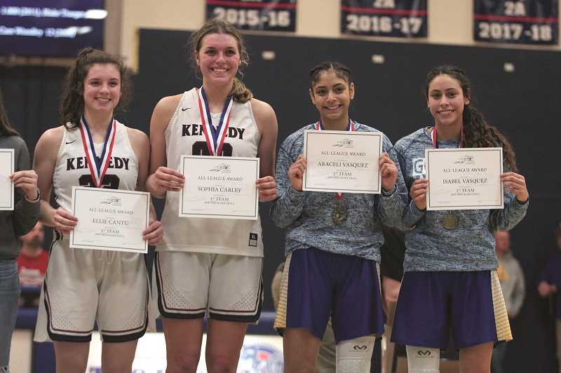 PMG PHOTO: PHIL HAWKINS - From left: Kennedy's Ellie Cantu and Sophia Carley, along with Gervais' Araceli Vasquez and Isabel Vasquez were named to the Tri-River Conference First Team at the end of Saturday's game.