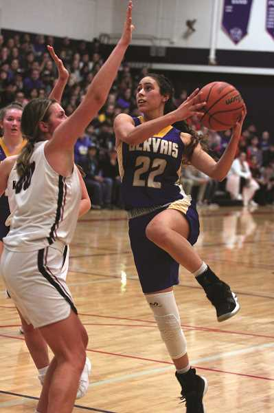 PMG PHOTO: PHIL HAWKINS - Gervais senior Isabel Vasquez challenges Kennedy senior Sophia Carley in the lane in Saturday's Tri-River Conference championship game.
