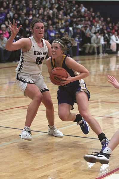 PMG PHOTO: PHIL HAWKINS - Junior wing Katie Hanson led the Cougars in scoring for the second straight game, dropping 13 points against the Trojans.
