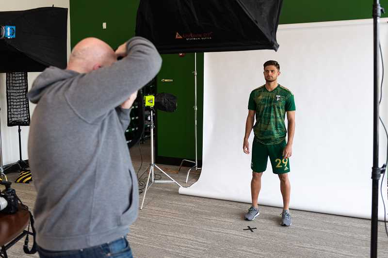 PMG PHOTO: CHRISTOPHER OERTELL - Team photographer Craig Mitchelldyer takes a photo of forward Ryan Sierakowski during media day at the Timbers Training Facility in Beaverton, Ore., on Tuesday, Feb. 25, 2020.