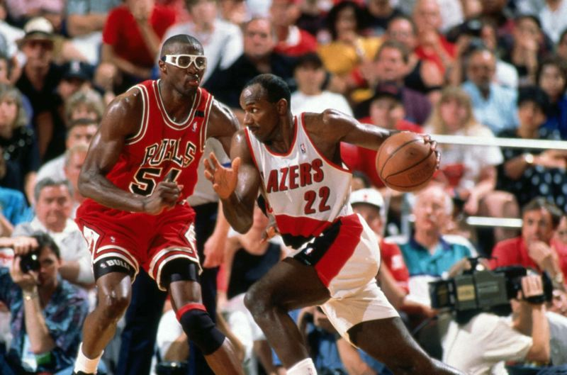 COURTESY PHOTO: ANDREW D. BERNSTEIN/GETTY IMAGES - Clyde Drexler (right) drives for the Trail Blazers against Horace Grant of the Chicago Bulls during the 1992 NBA Finals.