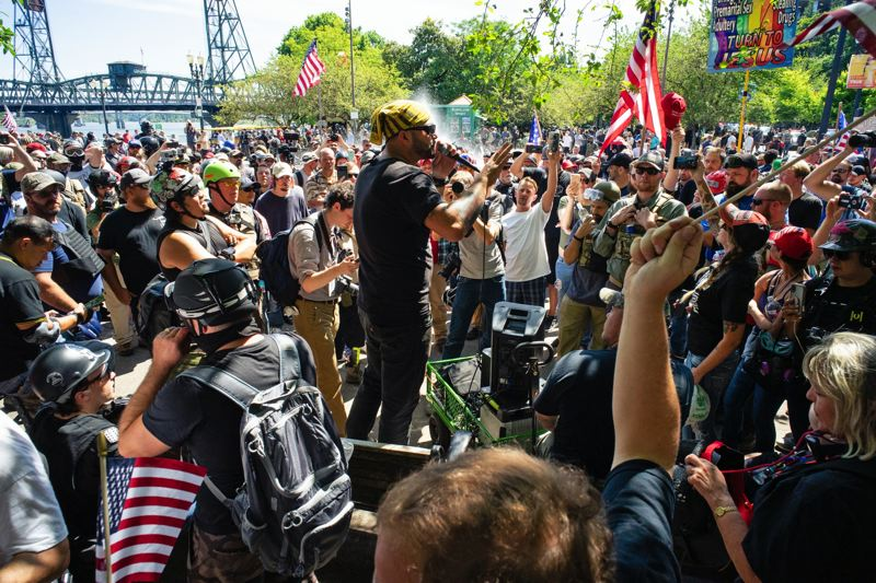 PMG FILE PHOTO - Joey Gibson, leader of Patriot Prayer, addresses a crowd of supporters gathered on the Tom McCall Waterfront Park in Portland in August 2018.