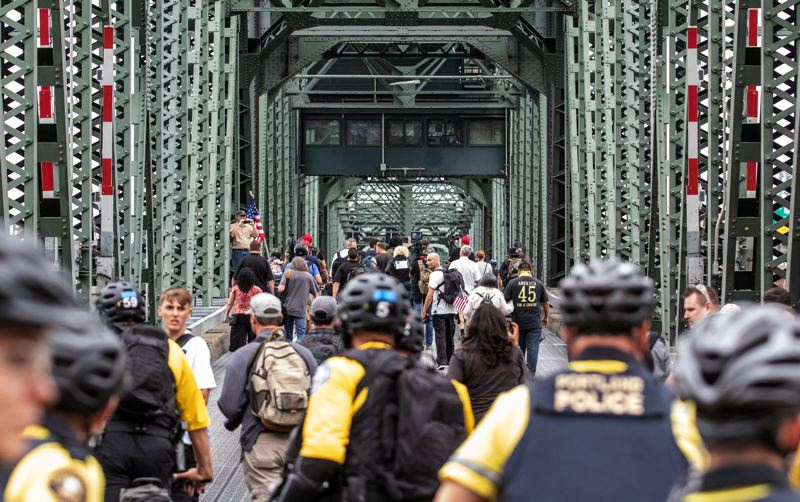 PMG FILE PHOTO - Members of Patriot Prayer, Proud Boys, and other alt-right groups were escorted back to the east side of the Hawthorne Bridge during an August 2018 rally.