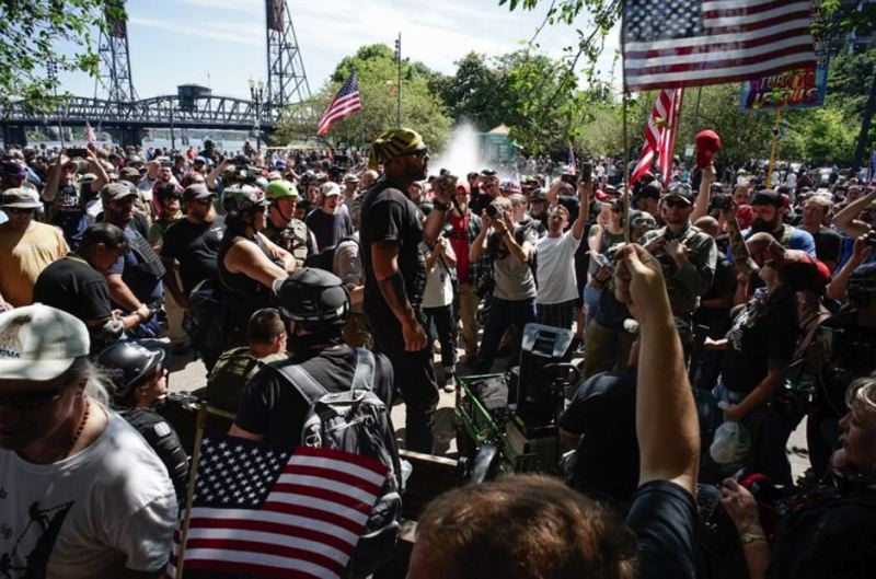 PMG FILE PHOTO - Joey Gibson, leader of the right-wing Patriot Prayer group, spoke with supporters during an August 2018 protest in downtown Portland.