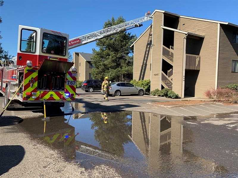 PMG PHOTO: JAIME VALDEZ - A fire burned two units at the Lombard Plaza apartments Thursday morning, resulting in two people being taken to the hospital to be treated for burns.