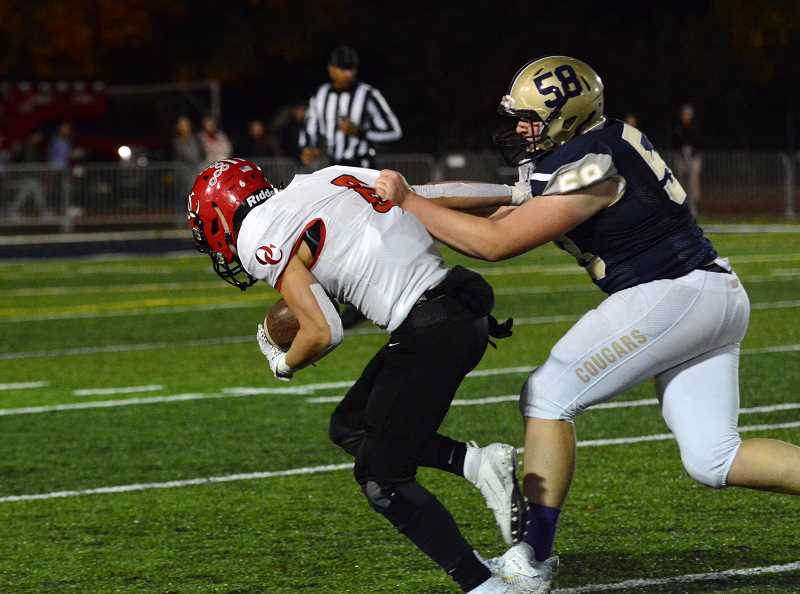PMG PHOTO: DEREK WILEY - Canby sophomore lineman Brayden Wise tackles an Oregon City player during the 2019 season. The Cougars will play a 5A schedule in 2020.