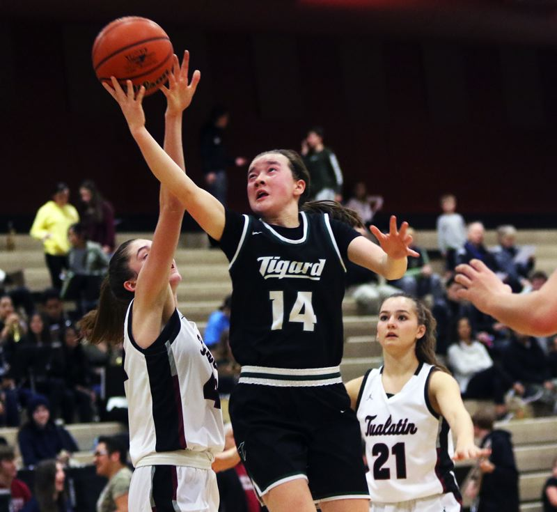 PMG PHOTO: DAN BROOD - Tigard High School freshman Hailey Shimojima goes up for a layup right before halftime of the Tigers' Three Rivers League game at Tualatin.