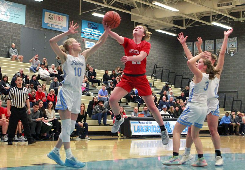 PMG PHOTO: MILES VANCE - Oregon City junior Mia Martineau goes to the basket during her team's 55-41 loss to Lakeridge at Lakeridge High School on Wednesday, Feb. 26.