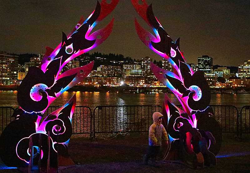 DAVID F. ASHTON - With downtown Portland for a backdrop, people stopped along the Willamette Rivers East Bank Esplanade to see works like this one - Mihlys Gate.