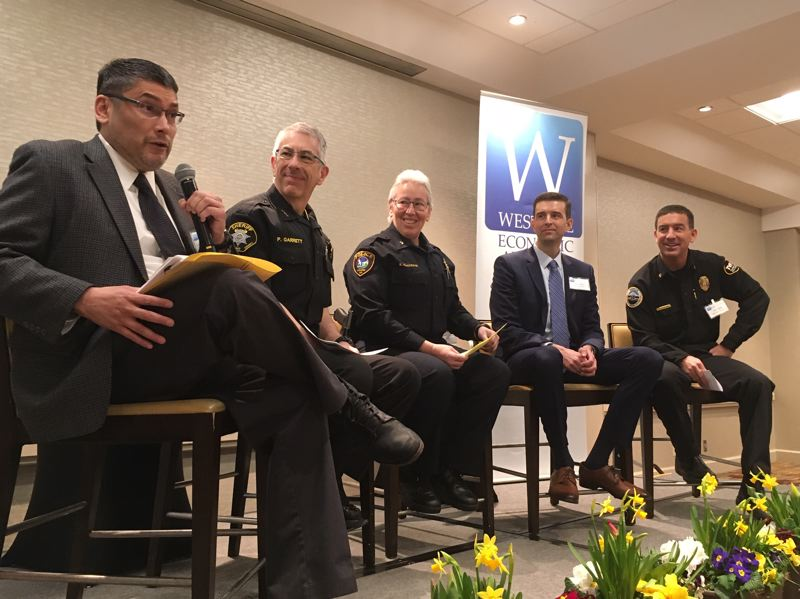 PMG PHOTO BY PETER WONG - Washington County Sheriff Pat Garrett, second from left, at a Westside Economic Alliance breakfast forum Thursday, Feb. 27, at Embassy Suites in Tigard, where he gave a public explanation for the county's compliance with subpoenas by federal immigration authorities seeking information about two jail inmates. Others from left are Circuit Judge Oscar Garcia, Tigard Police Chief Kathy McAlpine, District Attorney Kevin Barton and Chief Deric Weiss of Tualatin Valley Fire & Rescue.