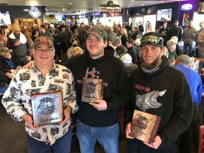 COURTESY PHOTO: STEVE JOHNSON  - At last years inaugural John Aho Memorial Steelhead Derby, from left, Dave Walker Sr., of Damascus, took first place, Dave Walker, Jr., of Happy Valley, got third place; and Chris Walker, of Maryland, won second place.