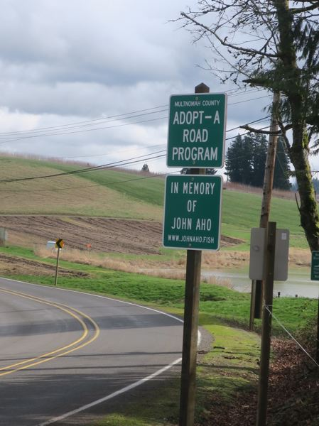 COURTESY PHOTO - Signs honoring the late John Aho were installed earlier in February by Multnomah County highway crews near Oxbow Park on the Sandy River, one of Ahos favorite fishing holes.