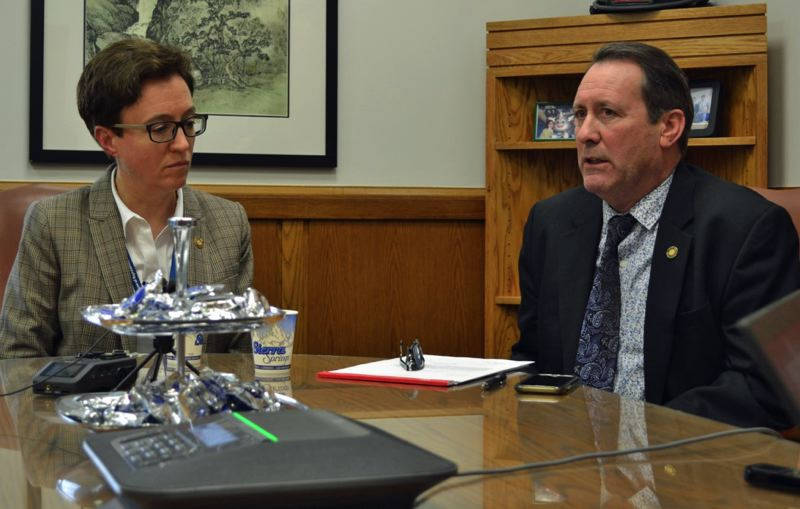 PMG PHOTO: CLAIRE WITHYCOMBE - Speaker of the House Tina Kotek, D-Portland, and Rep. Paul Holvey, D-Eugene, speaking to reporters on Thursday.