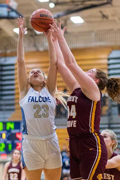 PMG PHOTO: CHRISTOPHER OERTELL - Liberty's Bella Hamel (23) and Forest Grove's Olivia Grosse (44) during a girls basketball game at Liberty High School in Hillsboro, Ore., on Thursday, Feb. 27, 2020.