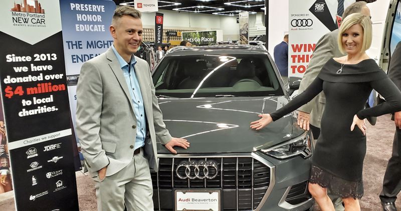 COURTESY MPNCDA - After the raffle at the Sneak Peek Charity Party, winners Jennifer and Brian Cornilles posred with their news Audi.