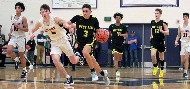 PMG PHOTO: MILES VANCE - Lake Oswego's Jack Chlumak and West Linn's Jackson Shelstad will be back in action tonight (Friday, Feb. 28) when the Lions host the Lakers at West Linn High School at 7:30 p.m.