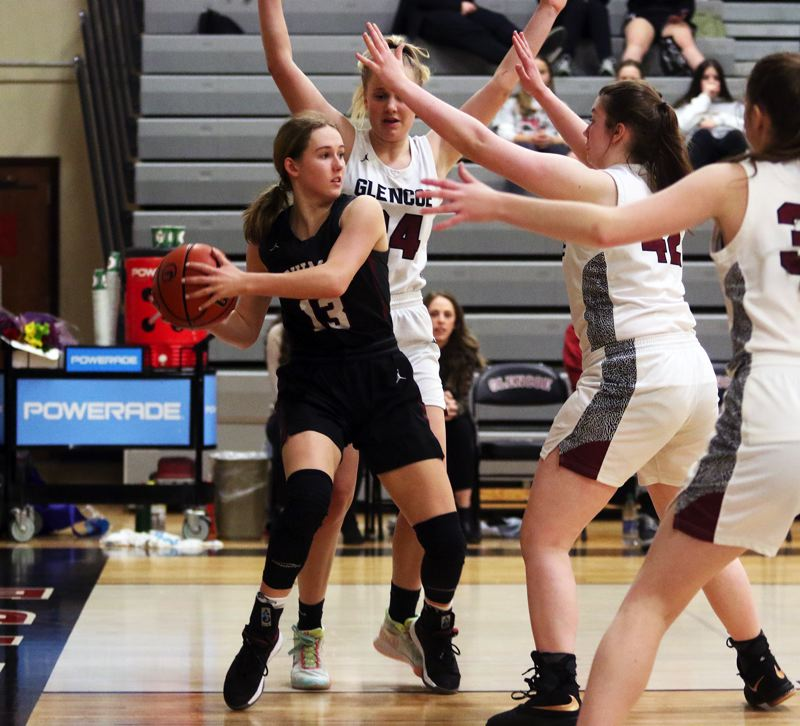 PMG PHOTO: DAN BROOD - Sherwood High School junior Joley Sproul (13) looks to make a pass from the baseline during the Lady Bowmen's 34-32 Pacific Conference victory over Glencoe.
