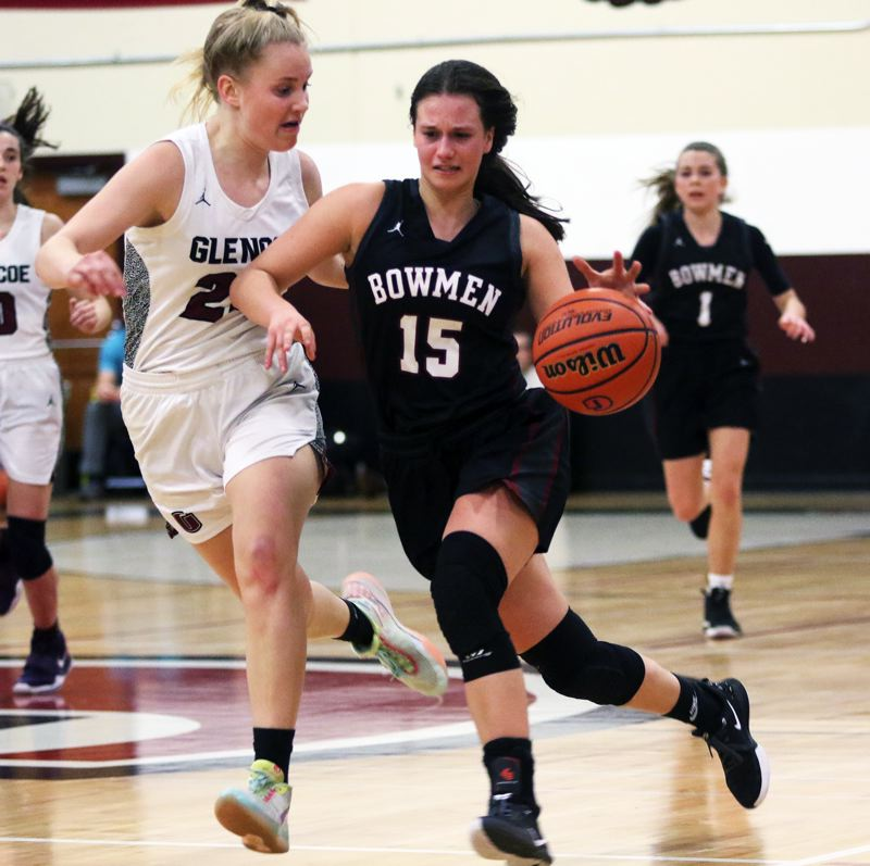 PMG PHOTO: DAN BROOD - Sherwood High School sophomore Mandie Jensen brings the ball upcourt in a hurry during the Lady Bowmen's 34-32 Pacific Conference victory at Glencoe.