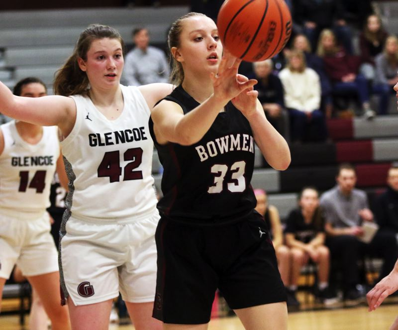 PMG PHOTO: DAN BROOD - Sherwood High School sophomore Klaira Ray (33) passes the ball out of the post during the Lady Bowmen's 34-32 Pacific Conference win at Glencoe.
