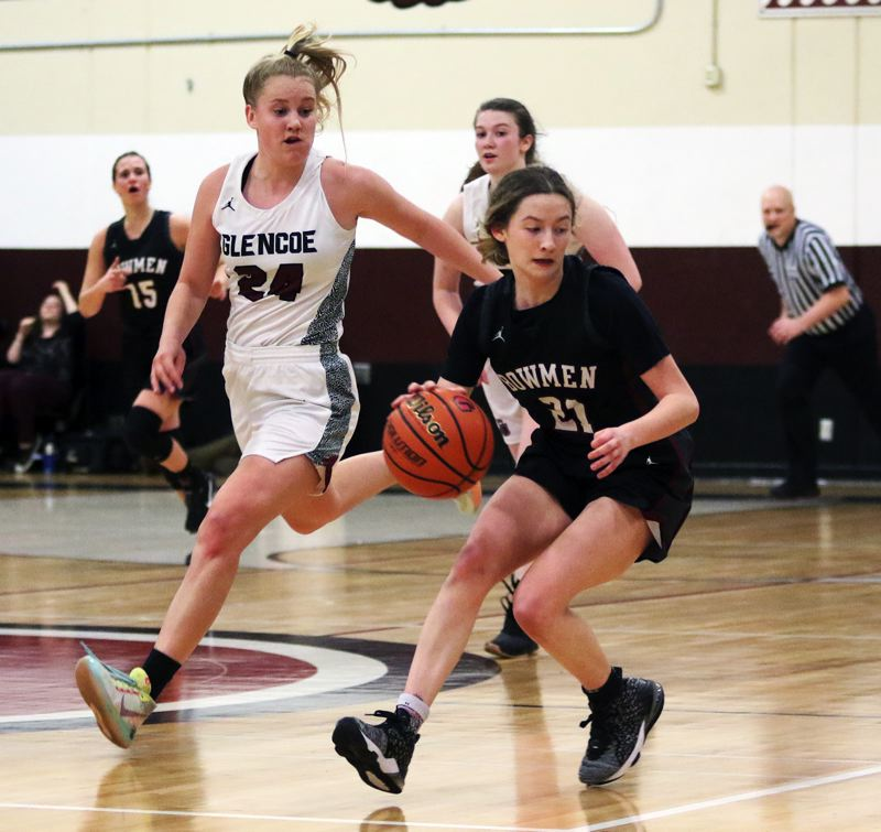 PMG PHOTO: DAN BROOD - Sherwood High School senior Ava Boughey (21) gets the ball over midcourt during the Lady Bowmen's 34-32 conference victory at Glencoe.