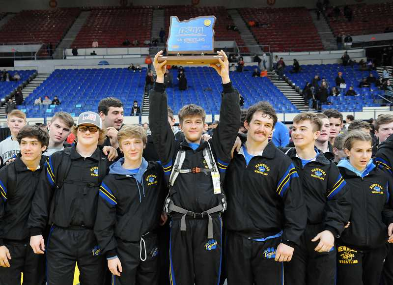 GRAPHIC PHOTO: GARY ALLEN - Newberg earned a 6A state wrestling title for the first time since 2009 after outdistancing Roseburg Saturday evening at Memorial Coliseum in Portland.