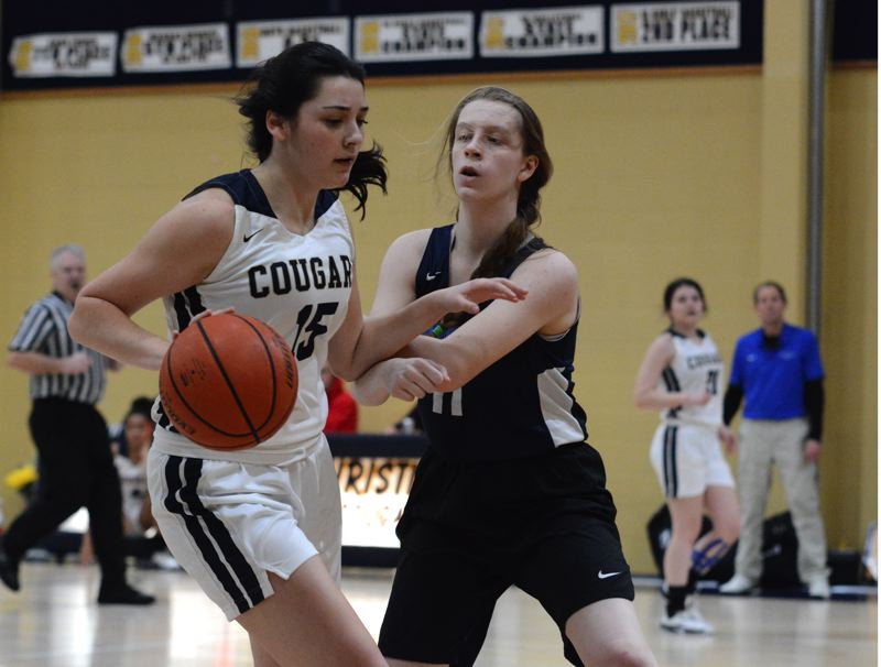 PMG PHOTO: DEREK WILEY - Country Christian freshman Annie Bafford scored six points in the fourth quarter of Saturday's victory against Rogue Valley Adventist Academy in Medford.