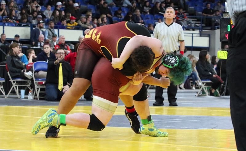 PMG PHOTO: JIM BESEDA - Milwaukies Fiona McConnell takes Ontarios Abigail Osei off her feet and onto the mat for a second-round pin, clinching the girls 190-pound wrestling state title Saturday at Veterans Memorial Colieum.