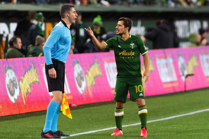 PMG PHOTO: CHRISTOPHER OERTELL - Sebastian Blanco of the Timbers has a word with a linesman.