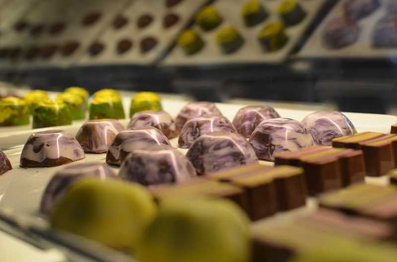 PMG FILE PHOTO: JOHN WILLIAM HOWARD - Purple and pearl chocolates sit at Study of Sweets chocolate shop in Hillsboro. The stores owner closed the store to the public due to the coronavirus epidemic.