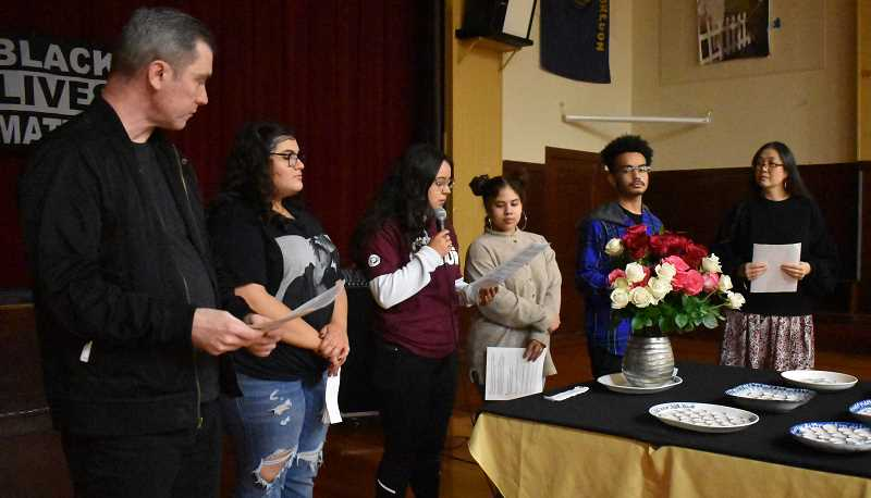 PMG PHOTO: RAYMOND RENDLEMAN  - Participants in the Unarmed and Unforgotten ceremony at New Urban High School included Grant Cunningham (from left), Addison Salimi, Dayana Ruff, Mia Castille, Gabe Davis and Annarie Wergeland.