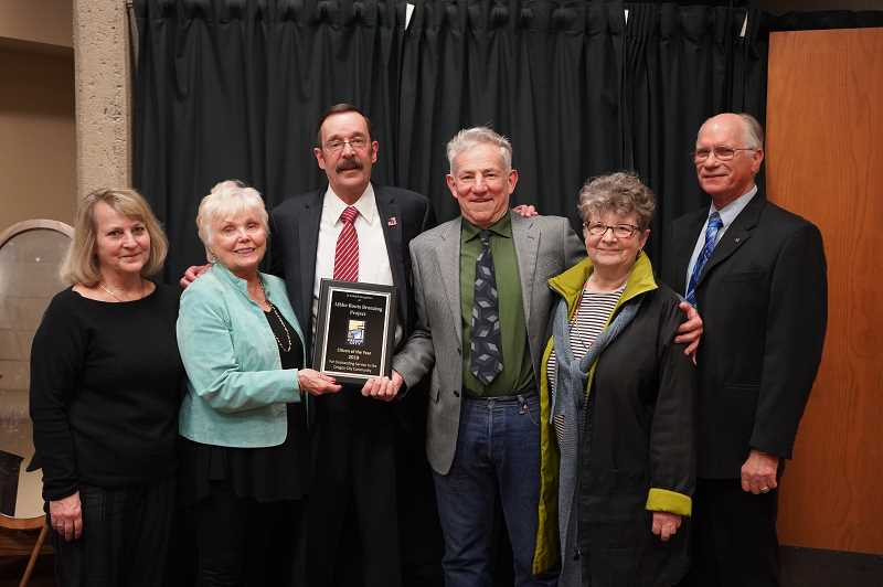 COURTESY PHOTO - Mayor Dan Holladay honors members of the Robert Libke Boot Bronzing Project as Oregon City Citizens of the Year.