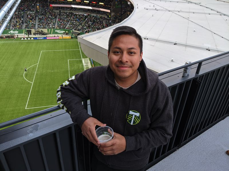 PMG PHOTO: JOSEPH GALLIVAN  - Kevin Velasquez is a server at Warehouse 23 in Vancouver, Washington, expects the Timbers to win the MLS Cup in 2020. His boss bought four tickets on OfferUp and took Velasquez and two more friends to the game.