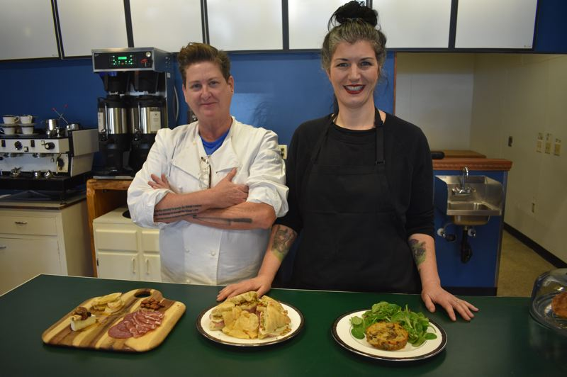PMG PHOTO: SHANNON O. WELLS  - A Boring Life Cafe and Market founders Jennifer Johnson and Serafina Palandech show off some of the gluten- and processed sugar-free menu items Johnson created for the brand-new Damascus business.