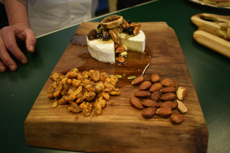 PMG PHOTO: SHANNON O. WELLS  - Brie cheese, walnuts, almonds and honey are among the locally sourced food items Jennifer Johnson features on A Boring Life's food menu.